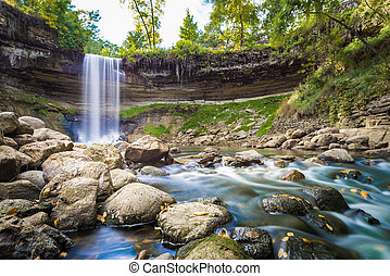 Waterfall during autumn - Waterfall in Minnesota during...