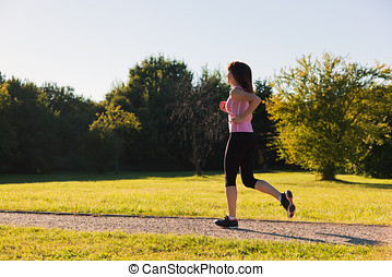 Young fit woman does running, jogging training