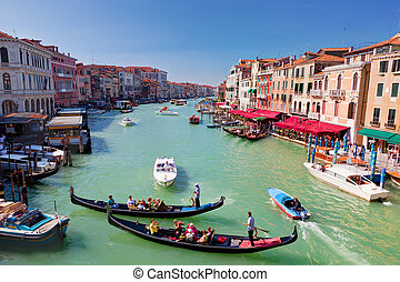 Venice, Italy Gondola with tourists floats on Grand Canal,...
