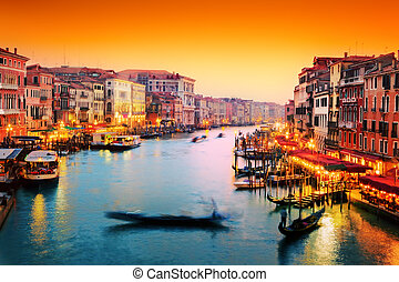 Venice, Italy. Gondola floats on Grand Canal at sunset -...