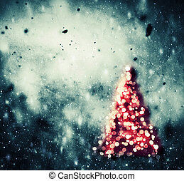 Christmas tree glowing on winter vintage background -...