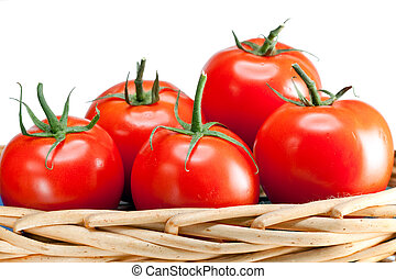 The ripened tomatoes in a wattled basket