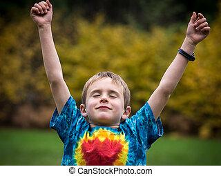 Happy boy celebrating