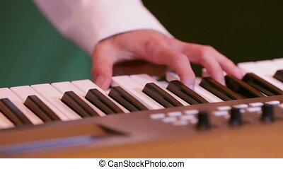 Keyboard synthesizer - Keyboard player playing on...