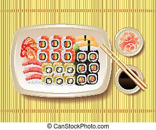 Sushi and chopsticks on bamboo mat - Japanese sushi, soy...