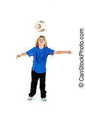 heading ball - Portrait of a young soccer player heading...