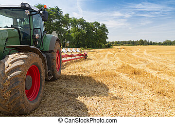 Tractor ready to plow stubble fields - Agricultural tractor...