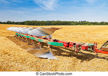 Plough ready to work on stubble field