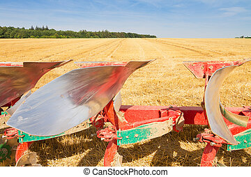 Detail of agriculture plow and stubble field
