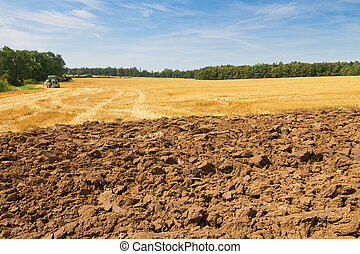 Landscape with partly ploughed field and stubble