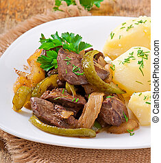 Fried chicken liver with apples, sweet pepper and onions