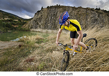 Mountain bike adventure - Young guy ridinf mountain bike...