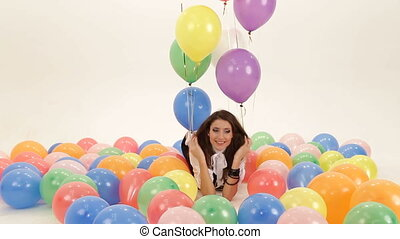 Among baloons - Woman among colorful baloons