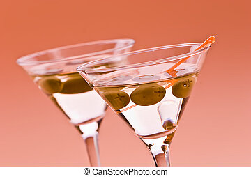 martini - two bocal of martini with olive over orange