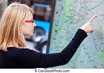 Woman looking on the metro map board - Woman orientating...