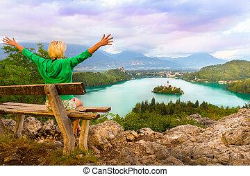 Lake Bled in Julian Alps, Slovenia. - Traveler enjoying the...