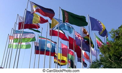 International flags and blue sky