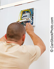 Fixing Electric Fuse at Home - Man assembling or fixing...