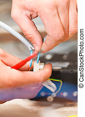 Electrician Fixing Devices - Electrician repairing electric...