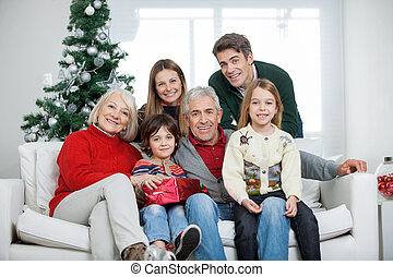 Family With Christmas Present In House - Portrait of happy...