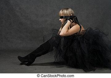 Blindfolded girl waiting. She weared black tutu skirt -...