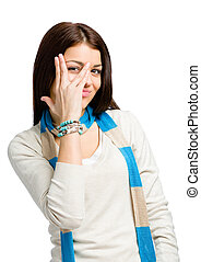 Teenager looks through fingers - Teenager wearing colored...