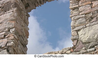 Cloudscape and stone window