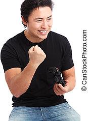 Yeah! - Young man having fun playing video games, wearing a...