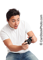 Wooh watch out! - Young man having fun playing video games,...