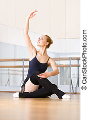 Ballerina works out sitting on the floor - Ballerina works...