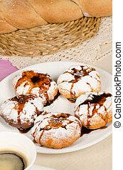 Sufganiyah - Portion of sufganiyah served with freshly made...