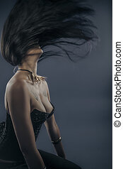 Hair in the wind, Fashion shoot of young bizarre woman in...