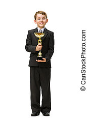 Full length of little businessman with gold cup