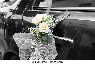 Wedding car with flowers - Door of black wedding car with...