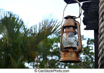 old lantern - old rusty lantern with natural background