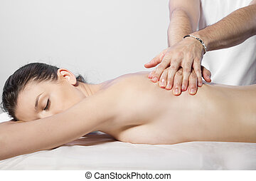 Beautiful brunette woman getting a massage
