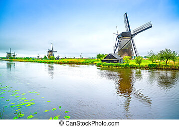 Windmills and canal in Kinderdijk, Holland or Netherlands....