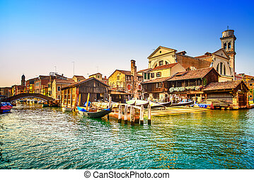 Venice, water canal, bridge and gondolas or gondole depot on...