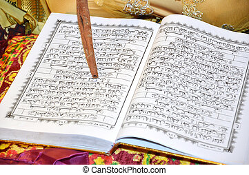 al quran with cinnamon, the Muslim holy book