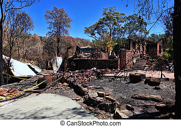 After bushfire, homes razed to the ground. - After the fire....