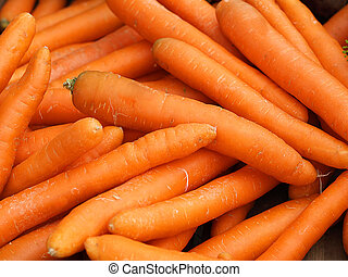Carrot pile - Close up of orange carrot pile presenting...