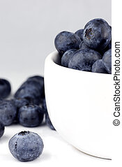blueberries in a bowl - fresh washed blueberries in a white...