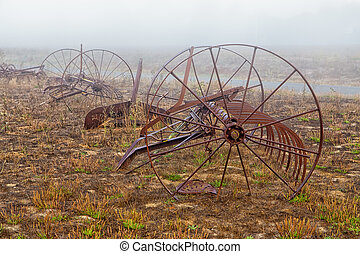 Rusting Old Horse Drawn Tiller Plow in the Morning Fog
