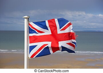 Flag - British flag fluttering in the wind on the shore