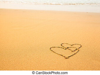 Shape of two hearts of the sea on the beach in Valentine Day. Soft wave of the sea.