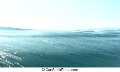 sea water line - Sea water surface with blue sky splitted by...