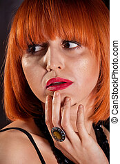 attractive adult redhead woman with red lips portrait