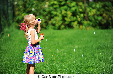 girl with bubble blower - little girl play with bubble...
