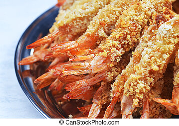 sauteed prawns - plate of sauteed prawns in breadcrumbs with...
