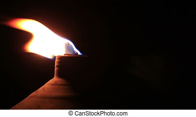 Tiki Torch Flame - Macro shot of tiki torch flame at the...
